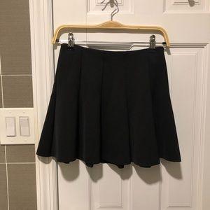 Topshop black skirt is size 4
